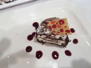 Chocolate roulade, winter berry coulis